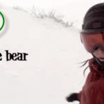 Snowboarder being chased by a huge bear- Oblivious while filming herself